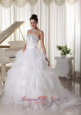 A-line Strapless Beaded Bridal Gown Tulle Ruffles Sweep Train