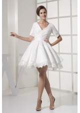 Short Sleeves V-neck Princess Ruched Bridal Gown with Lace Hemline
