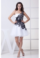 White Cool Back One Shoulder Prom Gowns with Black Lace Flowers and Sash