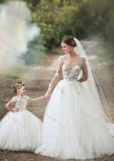 Feminine See Through Long Sleeves Perfect Wedding Dresses with Appliques and Lovely Big Puffy Flower Girl Dress with Hand Made Flowers