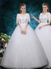 Unique Floor Length White Wedding Dresses Tulle Short Sleeves Beading and Appliques