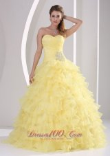 Light Yellow Ruffles Quinceaners Gowns Appliques and Ruch Organza
