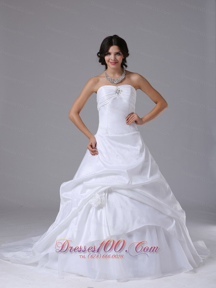 Strapless ball gown wedding dress chapel train pick ups for Best selling wedding dresses