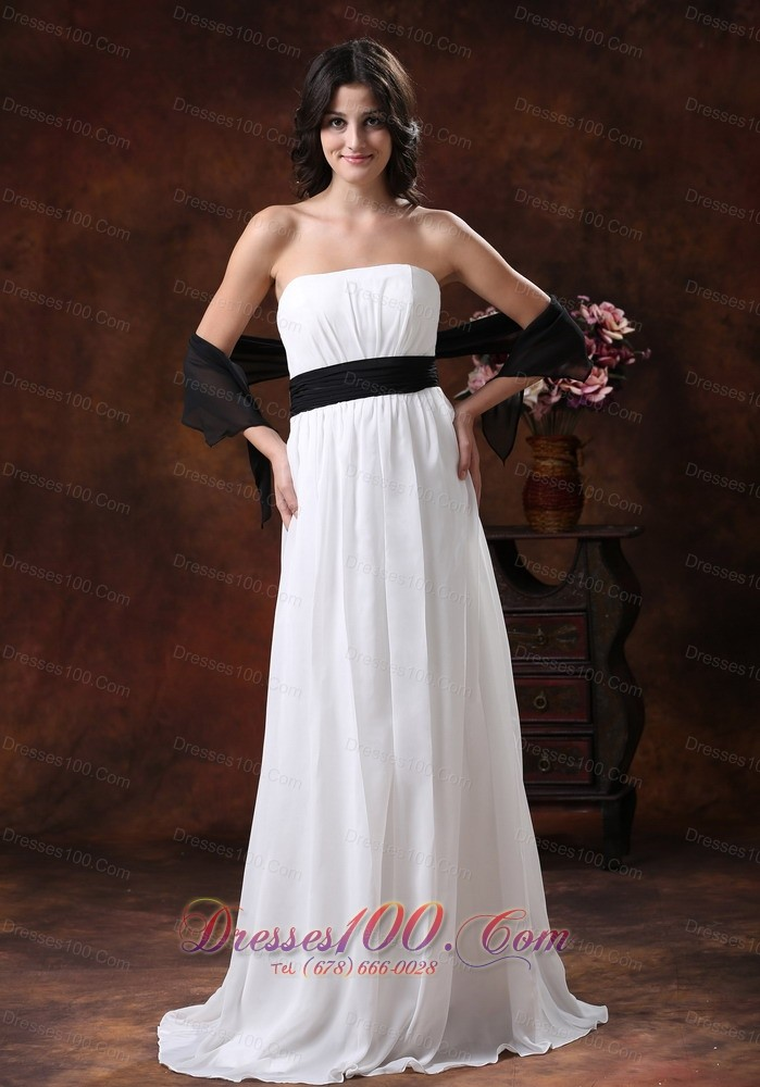 white chiffon brush wedding dress with black belt